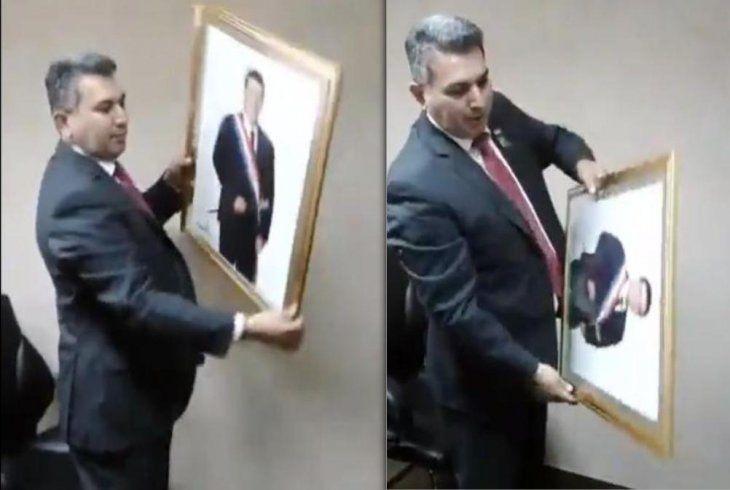 Secuencia del video donde se ve a Silvio Piris cuando baja la foto de HC.